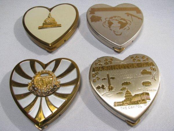 6: FOUR ASSORTED HEART SHAPED SOUVENIR COMPACTS