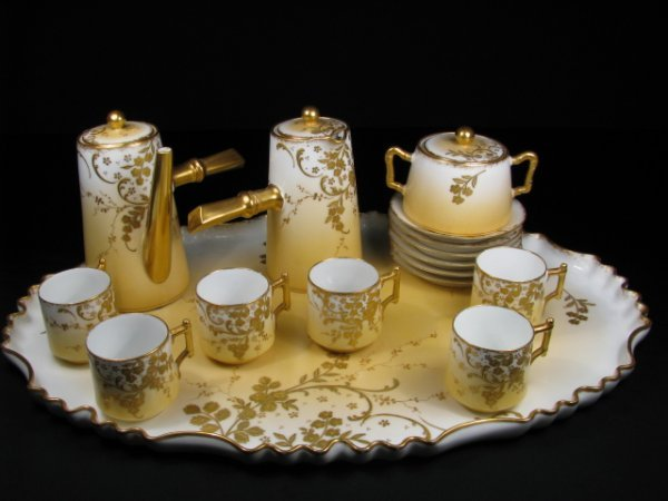 149: LIMOGES PORCELAIN GILT DECORATED DEMITASSE SET