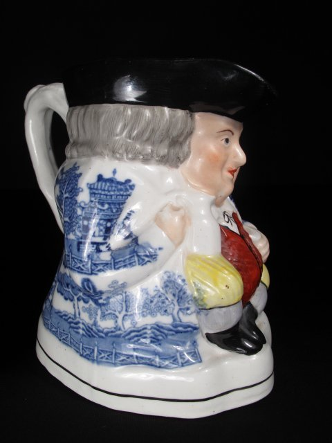 17: 19TH C STAFFORDSHIRE POTTERY TOBY MUG SEATED RED VE