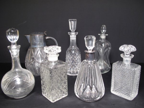 11: SIX CRYSTAL DECANTERS & A PITCHER WATERFORD ETC