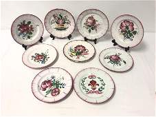 NINE FRENCH FAIENCE FLORAL PLATES, LES ISLETTES..