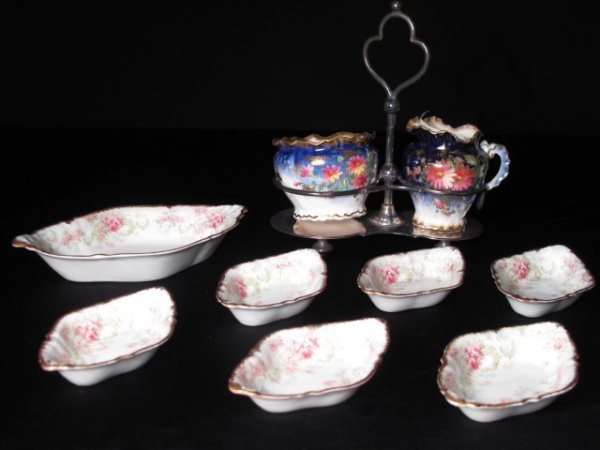 9: AN ENGLISH PORCELAIN CRUET & LIMOGES NUT DISHES
