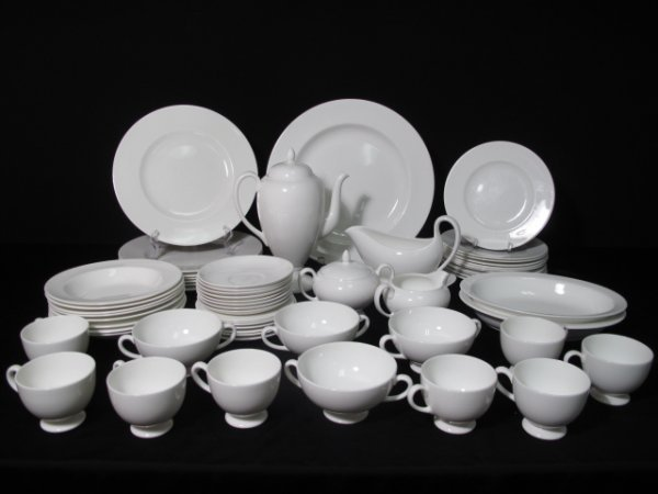 12: SIXTY PIECES WEDGWOOD WHITE BONE CHINA TABLE WARE
