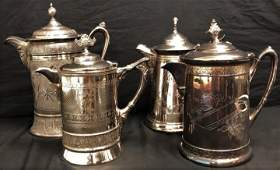 FOUR VICTORIAN SILVER PLATED WATER PITCHERS