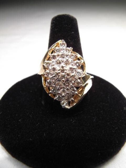 211: 14KT GOLD DIAMOND RING
