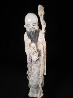 CHINESE CARVED IVORY FIGURE: MAN WITH DRAGON