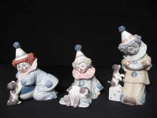 THREE LLADRO PORCELAIN CLOWNS WITH PUPPIES