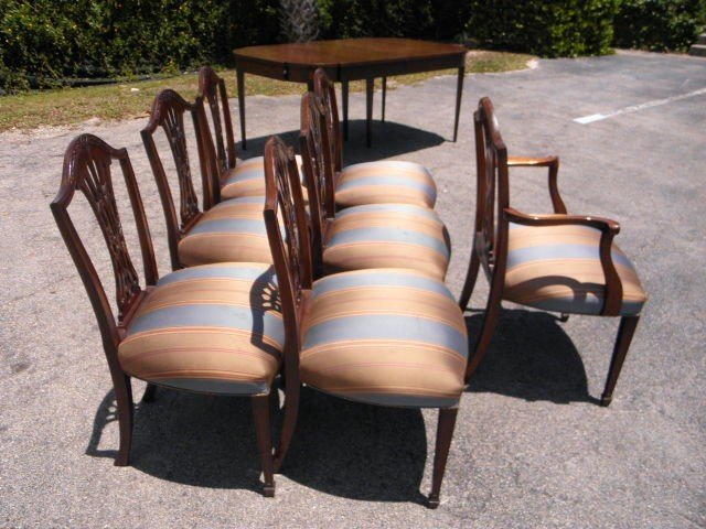 157: SEVEN CARVED MAHOGANY DINING CHAIRS