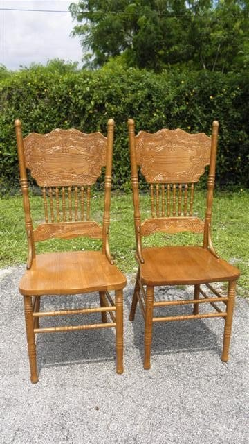 163: TWO PRESSED BACK OAK DINING CHAIRS