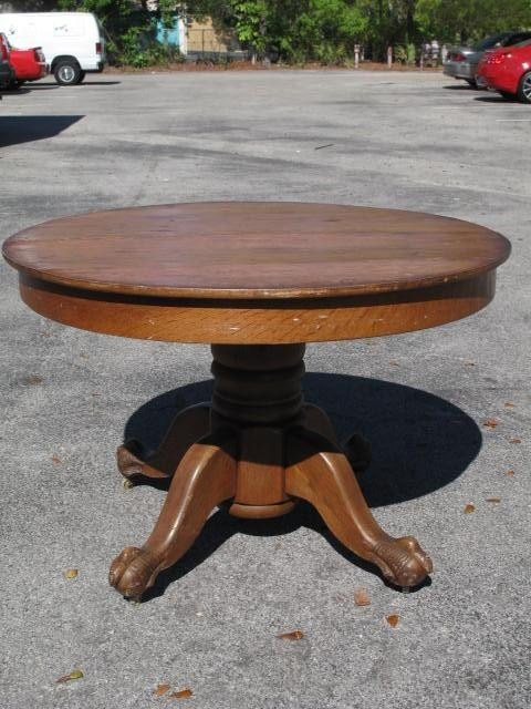 164: OAK PEDESTAL TABLE WITH CLAW FEET