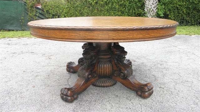 165: OUTSTANDING ROUND CARVED OAK CLAW FOOT TABLE