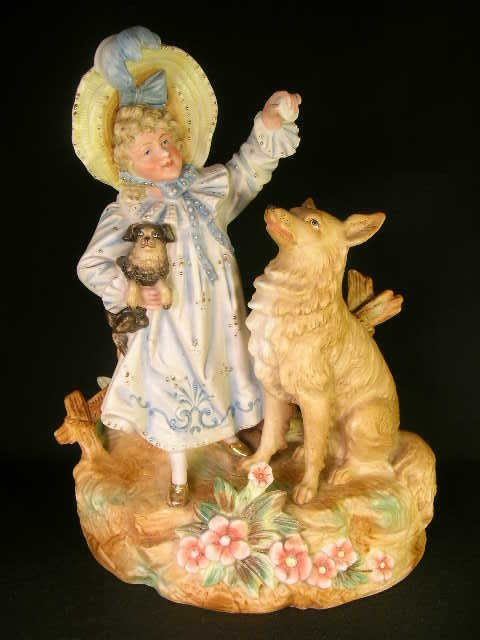 14: BISQUE HAND PAINTED STATUE OF GIRL PLAY WITH DOGS