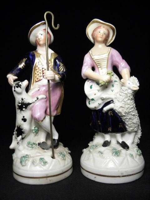 73: PAIR OF STAFFORDSHIRE PORCELANEOUS FIGURES