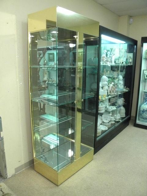 77: BRASS & GLASS DOUBLE DOOR LIGHTED DISPLAY CASE