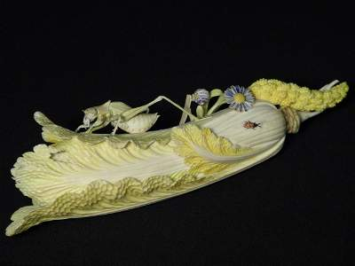 245: CHINESE CARVED IVORY VEGETABLE WITH GRASSHOPPER &