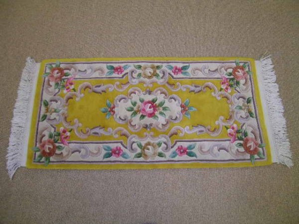 1161: WOOL HAND WOVEN MARIGOLD CARPET WITH ROSES