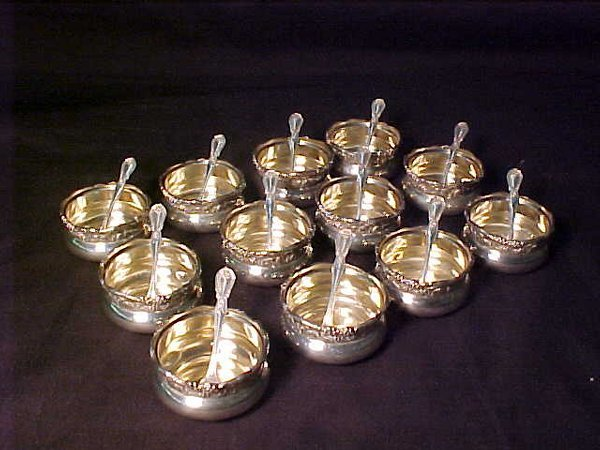 421: 12 STERLING SILVER SALTS WITH 12 STERLIN