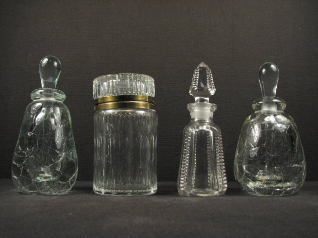 FOUR CONTEMPORARY GLASS PERFUME BOTTLES