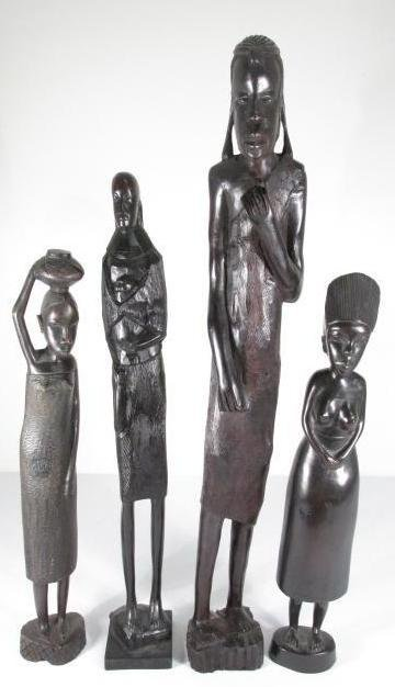 FOUR AFRICAN CARVED EBONY WOOD FIGURES