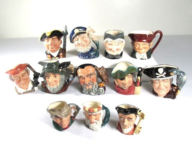TWELVE ASSORTED ROYAL DOULTON PORCELAIN TOBY JUGS