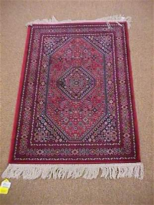 RED FLORAL MACHINE MADE AREA RUG