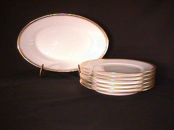 23: LIMOGES GOLD TRIM DINNER PLATES AND PLATTER