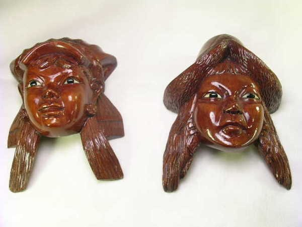 13: TWO CARVED ROSEWOOD? ASIAN WOMAN AND MANS HEAD