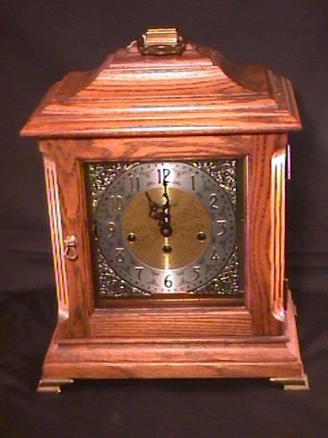 1021: HOWARD MILLER MANTEL CLOCK CHIME WOOD CASE