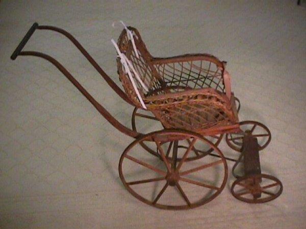 1022: ANTIQUE VICTORIAN WICKER CHILDS DOLLS CARRIAGE