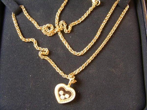 9: CHOPARD SWISS 18 KT GOLD DIAMOND HEART NECKLACE