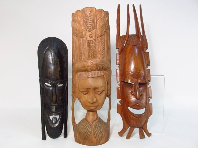 THREE INDO-ASIAN HAND CARVED TRIBAL MASKS/FIGURES