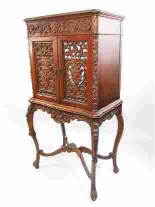 LATE 19TH/EARLY 20TH C CARVED WALNUT CABINET
