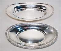 TWO STERLING SILVER BREAD TRAYS: 26.2 TROY