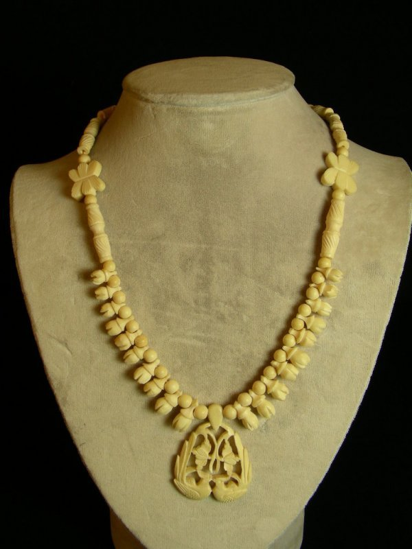 623: CARVED IVORY BONE NECKLACE WITH FLOWERS AND BIRDS