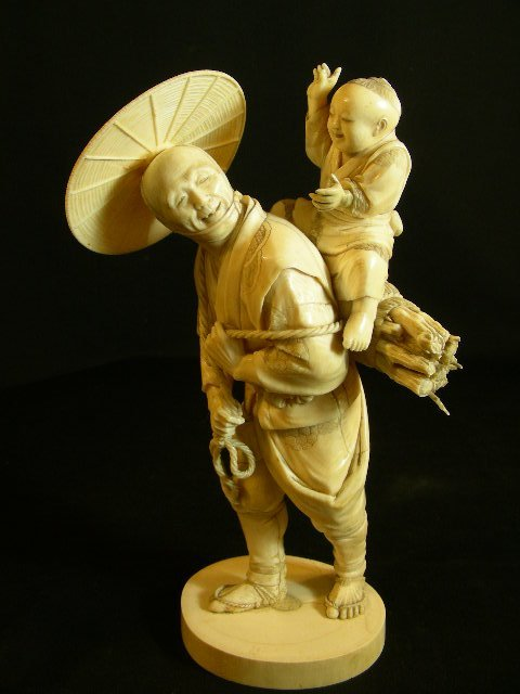 721: CARVED IVORY STATUE MAN CARRYING A CHILD