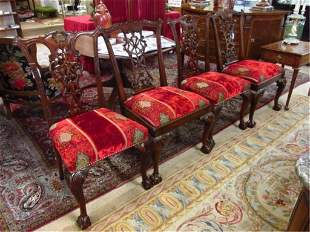 FOUR CHIPPENDALE STYLE MAHOGANY DINING CHAIRS