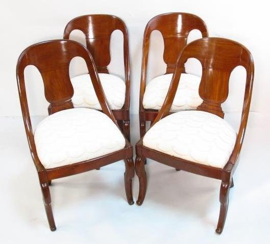 FOUR MID 19TH CENTURY CARVED WALNUT DINING CHAIRS