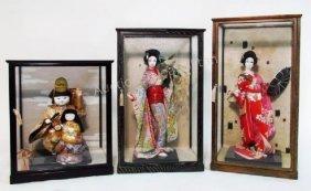 THREE JAPANESE GEISHA/CHILD DOLLS IN GLASS CASES