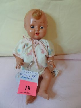 19: 11 1/2'' ''ok'' CELLULOID BABY DOLL WITH WAGGLY TON