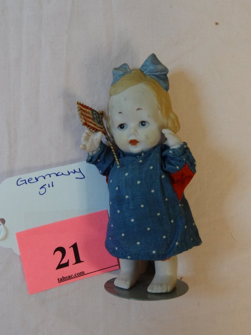 21: 5'' MOLDED BISQUE DOLL, RED, WHITE AND BLUE DRESS H