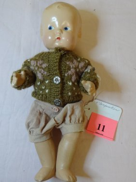 11: 11'' MOLDED COMPOSITION BABY DOLL IN BOY'S CLOTHES
