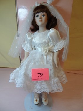 79: 13'' BISQUE DOLL IN WHITE DRESS AND VEIL. DESIGNED