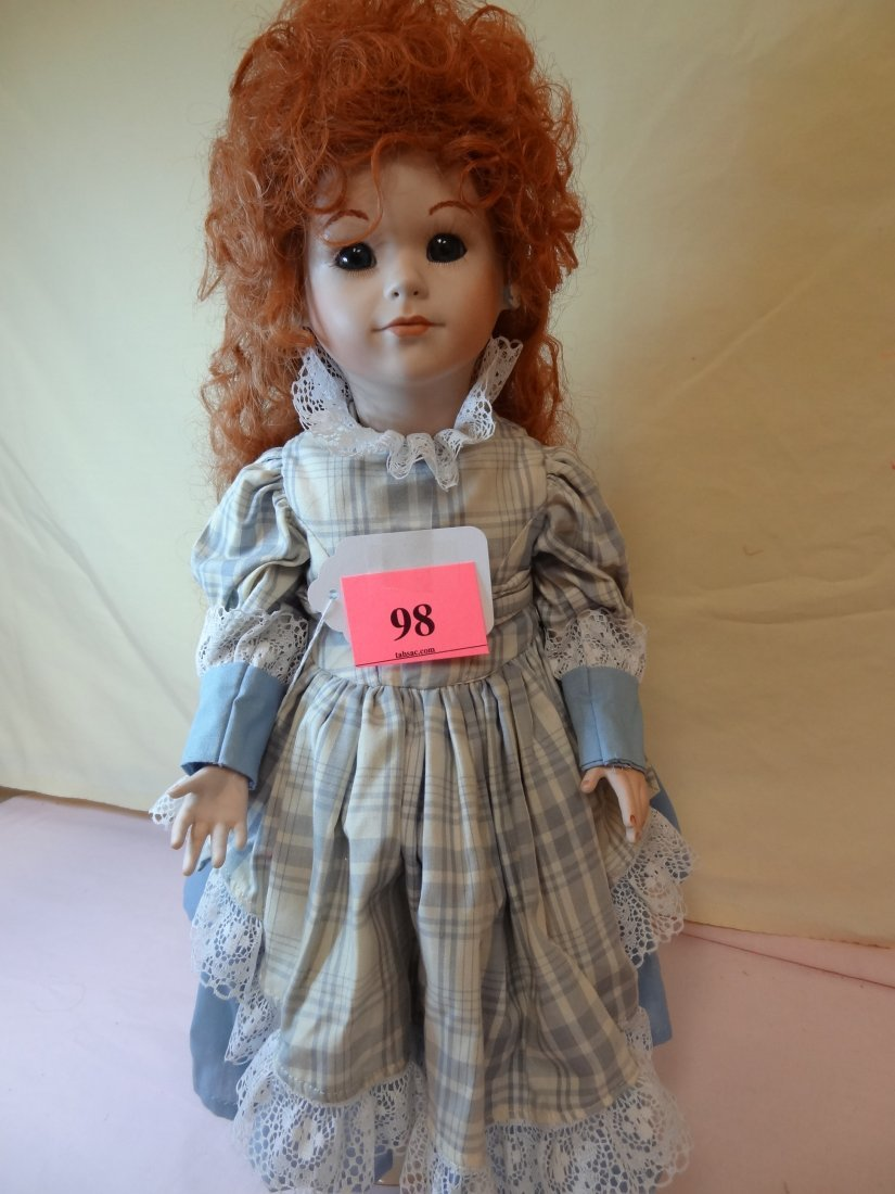 98: 19'' ALL PORCELAIN DOLL. MARKS ARE UP UNDER THE WIG