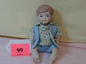 99: 7'' ALL BISQUE BOY DOLL. MOVEABLE HEAD, ARMS AND LE