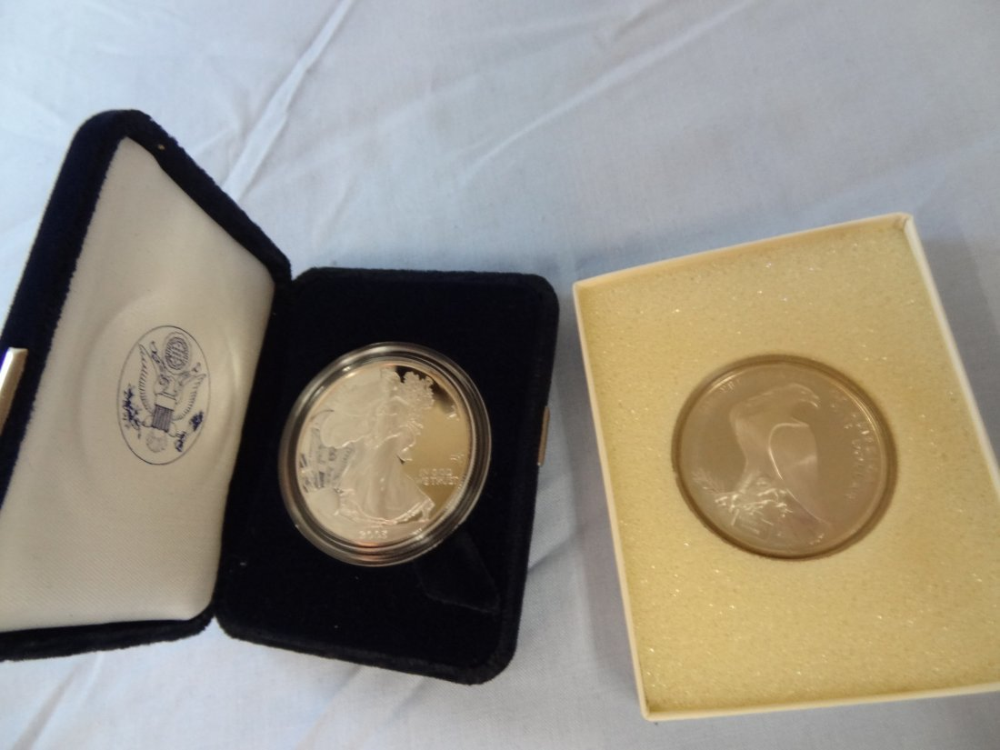 SILVER AMERICAN EAGLE ONE OUNCE COIN AND 1986 LOS ANGEL