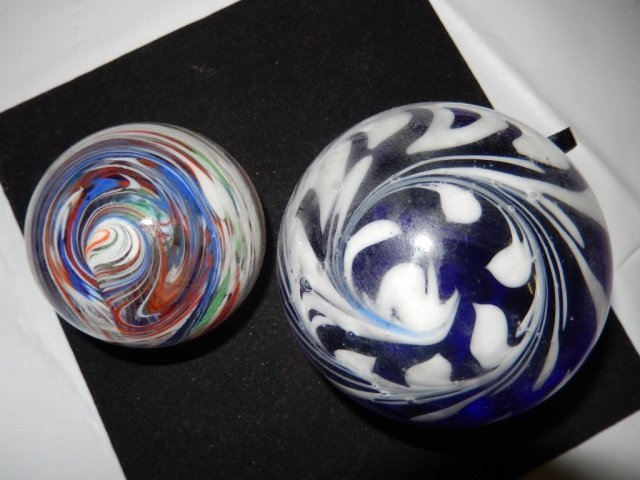 2 GLASS PAPERWEIGHTS LOT INCLUDES 2 GLASS PAPERWEIGHTS.