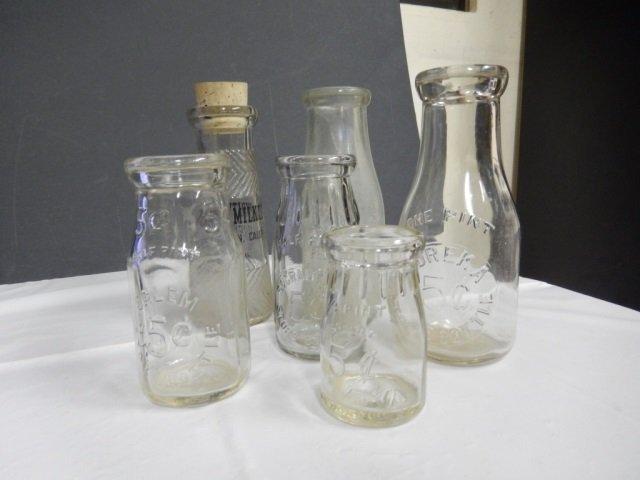 ANTIQUE MILK BOTTLES LOT INCLUDES 6 ANTIQUE CLEAR GLASS