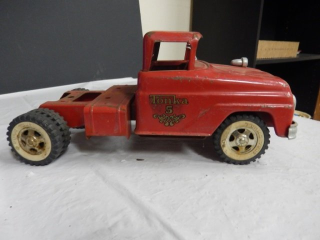 """VINTAGE TONKA TRUCK PAINTED RED METAL.  APPROX 12"""" LONG"""