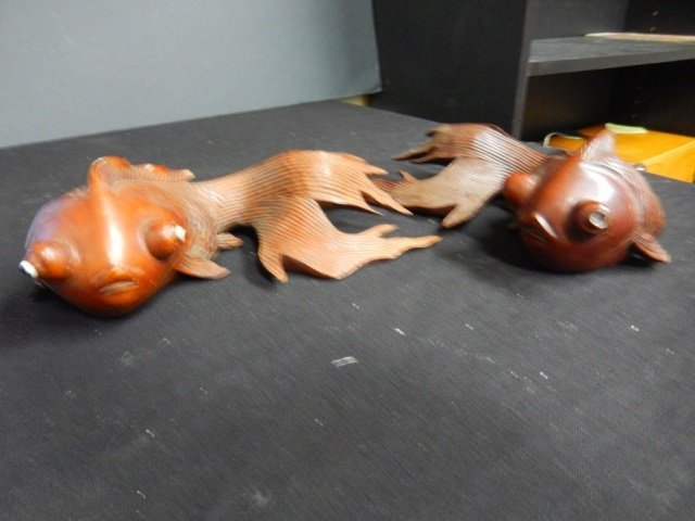 2 CARVED KOI FISH EACH KOI IS SIGNED AND HAS DAMAGE TO
