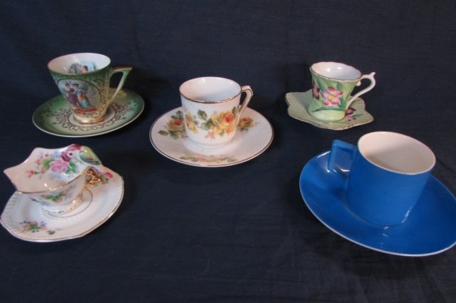 5 DEMITASSE CUP AND SAUCERS MARKED JAPAN, BAVARIA, AND